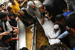 June 15, 2018 - Baramullah, Jammu and Kashmir, India - People bury the body of Shujaat Bukhari, slain Editor-in-Chief of the Kashmir Based Local English daily newspaper Rising Kashmir, during his funeral at Kreeri area of Baramullah District of Indian Administered Kashmir on 15 June 2018. Bukhari was killed after unknown gunmen shot on his vehicle killing Bukhari and two of his Body Guards. However, no Kashmir militant group has claimed the responsibility and has urged United Nations to probe the Killing of the Senior Editor internationally. (Credit Image: © Muzamil Mattoo/Pacific Press via ZUMA Wire)