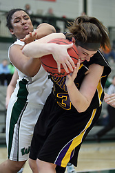 12 December 2015: Gabrielle Holness tries to get the ball from Allie Miceli  during an NCAA women's basketball game between the Wisconsin Stevens Point Pointers and the Illinois Wesleyan Titans in Shirk Center, Bloomington IL