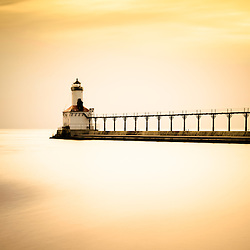 Picture of Michigan City lighthouse at sunset. The Michigan City East Pierhead Lighthouse is located in Michigan City, Indiana along the Lake Michigan shoreline.
