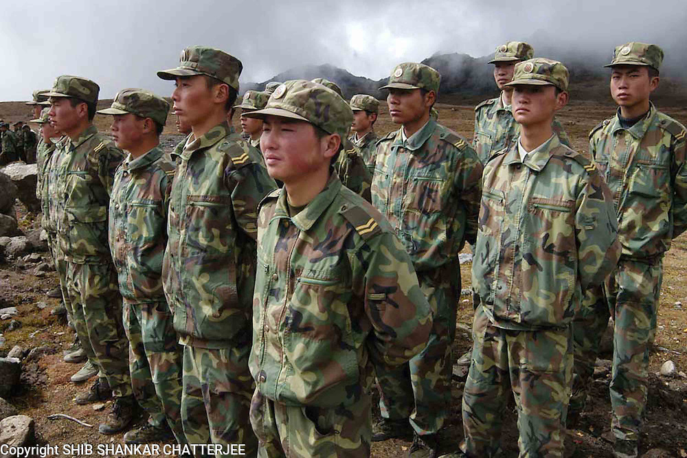 CHINESE SOILDERS ARE STANDING AT ARUNACHAL PRADESH (INDIA)-CHINA INTERNATIONAL BORDER DURING FRIENDSHIP MEET BETWEEN INDIA AND CHINA, FEW MONTHS AGO, WHILE INDIAN CHIEF OF ARMY STAFF OR  ARMY CHIEF, N.C.VIJ WILL VISIT CHINA ON 25TH OCTOBER, 2005. PICTURE-SHIB SHANKAR CHATTERJEE.