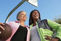 Senior women on outdoor basketball court