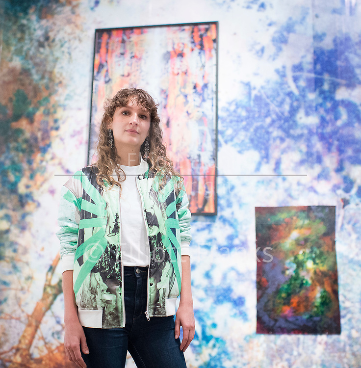 Shape of Light: 100 Years of Photography and Abstract Art <br /> at Tate Modern, Bankside, London SE1 9TG<br /> Press view 30th April 2018 <br /> <br /> Maya Rochat - artist <br /> <br /> Works by Maya Rochat b. 1985 <br /> A Rock is a River 2018 <br /> <br /> <br /> <br /> Shape of Light: 100 Years of Photography and Abstract Art will be the first show of this scale to explore photography in relation to the development of abstraction, from the early experiments of the 1910s to the digital innovations of the 21st century. Featuring over 300 works by more than 100 artists including Man Ray, Aaron Siskind, André Kertesz, Bridget Riley and Jackson Pollock, the exhibition will explore the history of abstract photography side-by-side with iconic paintings and sculptures.<br /> <br /> Photograph by Elliott Franks