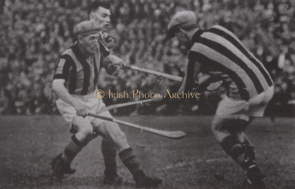 "Kilkenny's Paddy Larkin and goalkeeper Jimmy O'Connell and Tipperary's ""Sweeper"" Ryan in the 1937 All-Ireland Final in Kilkenny."