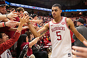 FAYETTEVILLE, AR - MARCH 9:  Jalen Harris #5 of the Arkansas Razorbacks celebrates with the student section after a game against the Alabama Crimson Tide at Bud Walton Arena on March 9, 2019 in Fayetteville, Arkansas.  The Razorbacks defeated the Crimson Tide 82-70.  (Photo by Wesley Hitt/Getty Images) *** Local Caption *** Jalen Harris