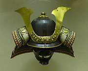 Helmet, iron with gilded copper decoration and stencilled leather; neck -guard of lacquered leather plates laced with silk.  Signed Myochin Nobuie, guardian of Echizer province of the Sano manor in Shimotsuke province on a day in the fourth month of the ninth year of Eisho (1512).  Half mask Iron - about 1700-1800.