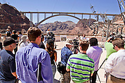 19 AUGUST 2010 --  HOOVER DAM, AZ: The media listens to a presentation on the Hoover Dam Bypass Bridge.  Construction work is continuing on the Hoover Dam bypass bridge. The Colorado River Bridge is the central portion of the Hoover Dam Bypass Project. Construction on the nearly 2,000 foot long bridge began in late January 2005 and the completion of the entire Hoover Dam Bypass Project is expected in late 2010.  When completed, this signature bridge will span the Black Canyon (about 1,500 feet south of the Hoover Dam), connecting the Arizona and Nevada Approach highways nearly 900-feet above the Colorado River.   PHOTO BY JACK KURTZ