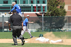 11 April 2015:  infielder Kaleb Krigbaum is high in the air above 2nd base as Tim Coonan slides safely in during an NCAA division 3 College Conference of Illinois and Wisconsin (CCIW) Pay in Baseball game during the Conference Championship series between the Millikin Big Blue and the Illinois Wesleyan Titans at Jack Horenberger Stadium, Bloomington IL