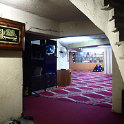 A former garage underneath a building serves as an illegal mosque in Neos Kosmos, which it has been called Al Salam Mosque.