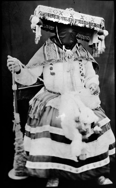 """In this June 12, 2017 photo taken with a 19th century style box camera, 30-year-old Ivan Flores poses for a portrait in the Sinakara Valley, during the Qoyllur Rit'i festival. Flores represents """"La Emilia"""", a man that is dressed as a woman in order to hide kindling under his skirt during a dance by members of the Tahuantinsuyo nation."""