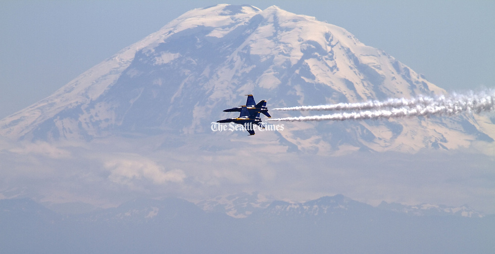 The Navy Blue Angels practice over Lake Washington as Mt. Rainier looms in the distance.<br />