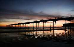 © Licensed to London News Pictures. <br /> 26/03/20167. <br /> Saltburn by the Sea, UK.  <br /> <br /> A spectacular sunrise starts the day over the beach in Saltburn by the Sea.<br /> <br /> Photo credit: Ian Forsyth/LNP