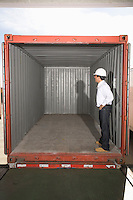 Man standing inside empty container