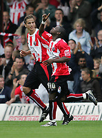 Photo: Lee Earle.<br /> Brentford v Bradford City. Coca Cola League 1. 02/09/2006. Brentford's Jo Kuffour (R) celebrates after scoring their winning goal.