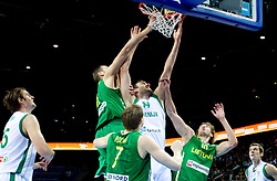 Mirza Begic of Slovenia between Jonas Valanciunas of Lithuania and Simas Jasaitis of Lithuania during basketball game between National basketball teams of Slovenia and Lithuania at of FIBA Europe Eurobasket Lithuania 2011, on September 15, 2011, in Arena Zalgirio, Kaunas, Lithuania.  (Photo by Vid Ponikvar / Sportida)