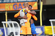 AFC Wimbledon goalkeeper George Long (1) hugging AFC Wimbledon defender Deji Oshilaja (4) during the EFL Sky Bet League 1 match between AFC Wimbledon and Doncaster Rovers at the Cherry Red Records Stadium, Kingston, England on 26 August 2017. Photo by Matthew Redman.