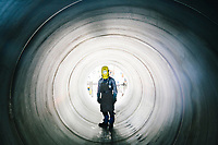 SANTA MARIA DEGLI ANGELI (ASSISI), ITALY - 11 JUNE 2018: A worker poses for a portrait in a helicoidal steel pipe at the IRON S.p.A. factory, a publicly traded company that makes industrial steel parts, in Santa Maria degli Angeli (Assisi), Italy, on June 11th 2018.<br /> <br /> President Donald Trump's administration plans to impose tariffs on European steel and aluminum imports after failing to win concessions from the European Union, a move that could provoke retaliatory tariffs and inflame trans-Atlantic trade tensions. Until the moment that the American president rendered his decision, Mr. Capponi, the commercial director of IRON spa, was confident the continent would be spared.<br /> Given that IRON is a purchaser of steel, the company might benefit from the American tariffs. Steel now shipped to the United States from mills within Europe might stay here to avoid the tariffs, raising the supply and dropping prices. Chinese producers who export to American shores could divert their product to Europe, amplifying this trend.<br /> But Mr. Capponi was banking on none of this. Even if steel prices decline, his customers are likely to squeeze him for lower prices. More broadly, the American tariffs — justified by the Trump administration as a supposed defense of national security — reverberated as a blow against world trade.