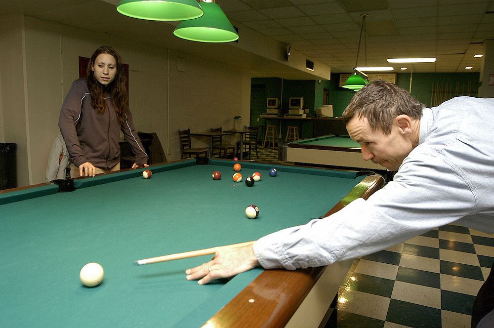 16260Dads day pool rec room and Green House Harold Blazier: Johnny Hanson..Senior, Betsy Gombas, and her father Greg, play pool in the rec. center during Dads weekend.