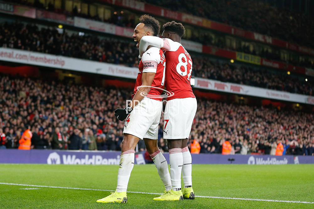GOAL 4-1 Arsenal striker Pierre-Emerick Aubameyang (14) celebrates with Arsenal midfielder Bukayo Saka (87) after Arsenal's fourth during the Premier League match between Arsenal and Fulham at the Emirates Stadium, London, England on 1 January 2019.