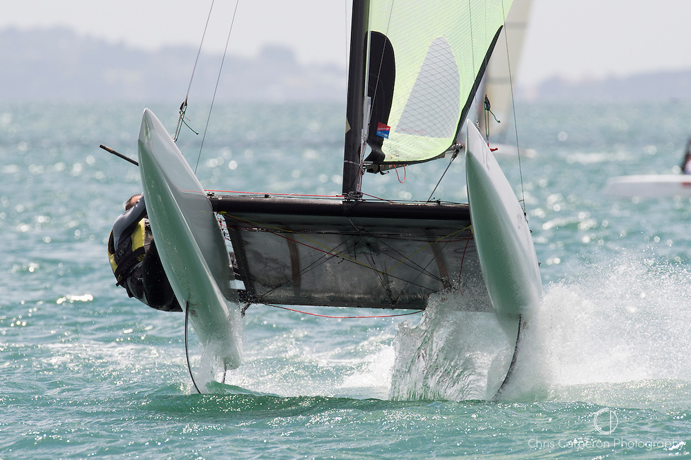 Luc du Bois (SUI10) gets air bourne at the top mark in race three of the A Class World championships regatta being sailed at Takapuna in Auckland. 12/2/2014