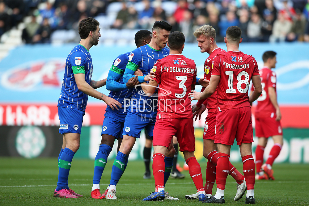 Nottingham Forest defender Tobias Figueiredo (3) and Wigan Athletic forward Kieffer Moore (19) get to grips with each other during the EFL Sky Bet Championship match between Wigan Athletic and Nottingham Forest at the DW Stadium, Wigan, England on 20 October 2019.