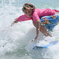 Robbie McCormick surfs Sunday July 13, 2014 during the 9th Annual O'Neil/Sweetwater Pro-Am Surf Fest at Wrightsville Beach, N.C. (Jason A. Frizzelle)