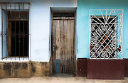 A girl sits in the window of her home in Trinidad, Cuba on Saturday July 5, 2008.