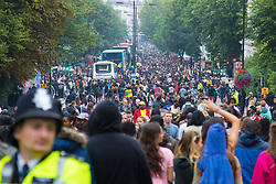 London, August 31st 2015. Revellers ignore the inclement weather to enjoy day two of the Notting Hill Carnival.