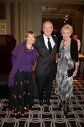 Left to right, MICHELE BRANDRETH, GYLES BRANDRETH and JOAN MORECAMBE widow of Eric Morecambe at the 90th birthday party for Nicholas Parsons held at the Hyatt Churchill Hotel, Portman Square, London on 8th October 2013.