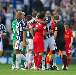 WEST BROMWICH, ENGLAND - Saturday, August 18, 2012: Liverpool's Luis Alberto Suarez Diaz embraces West Bromwich Albion's Romelu Lukaku after the opening Premiership match of the season at the Hawthorns. (Pic by David Rawcliffe/Propaganda)