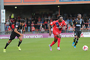 York City defender Marvin McCoy gets away from Mansfield Town defender Malvind Benning during the Sky Bet League 2 match between York City and Mansfield Town at Bootham Crescent, York, England on 29 August 2015. Photo by Simon Davies.