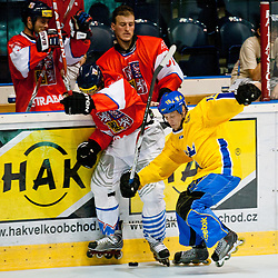 Petr Tenkrat of Czech Republic vs Carl Berglund of Sweden at IIHF In-Line Hockey World Championships 2011 Top Division quarter final match between National teams of Sweden and Czech Republic on June 24, 2011, in Pardubice, Czech Republic. (Photo by Matic Klansek Velej / Sportida)