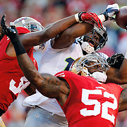 San Francisco 49ers free safety Dashon Goldson (38) and inside linebacker Patrick Willis (52) defend against Seattle Seahawks wide receiver Braylon Edwards (17) during an NFL game on Thursday, Oct. 18, 2012 in San Francisco. The 49ers won the game, 13-6. (AP Photo/Ric Tapia)