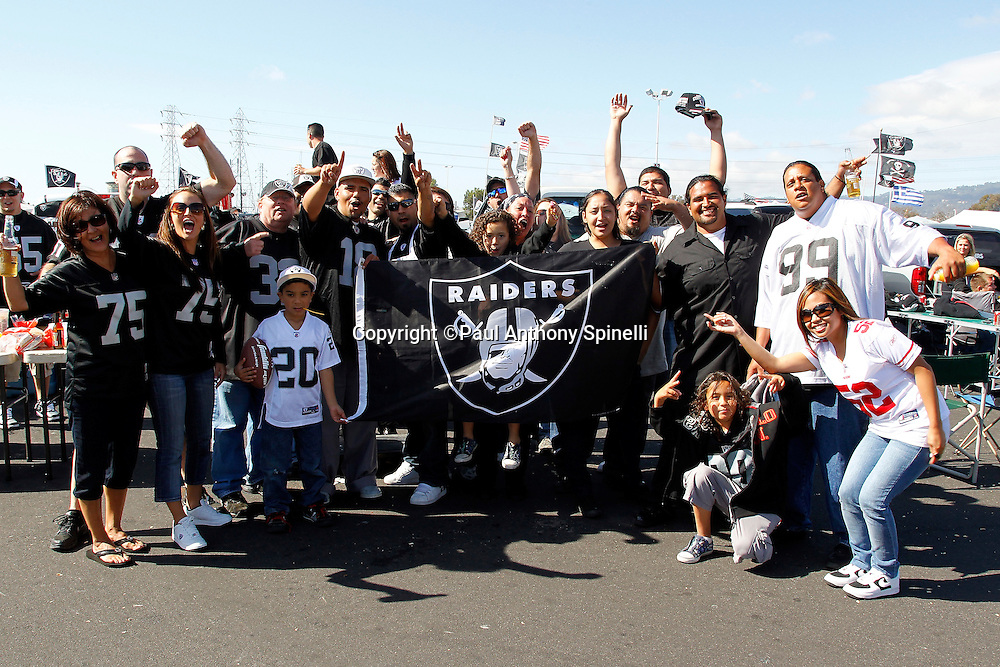 Oakland Raiders fans cheer for their team while tailgating during the NFL preseason week 3 football game against the San Francisco 49ers on Saturday, August 28, 2010 in Oakland, California. The 49ers won the game 28-24. (©Paul Anthony Spinelli)