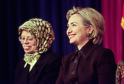 First lady Hillary Rodham Clinton (R) sits with a young muslim girl as she holds an event to mark the festival of Eid al-Fitr, the official end of the month long fast of Ramadan January 21, 1999 in Washington, DC.