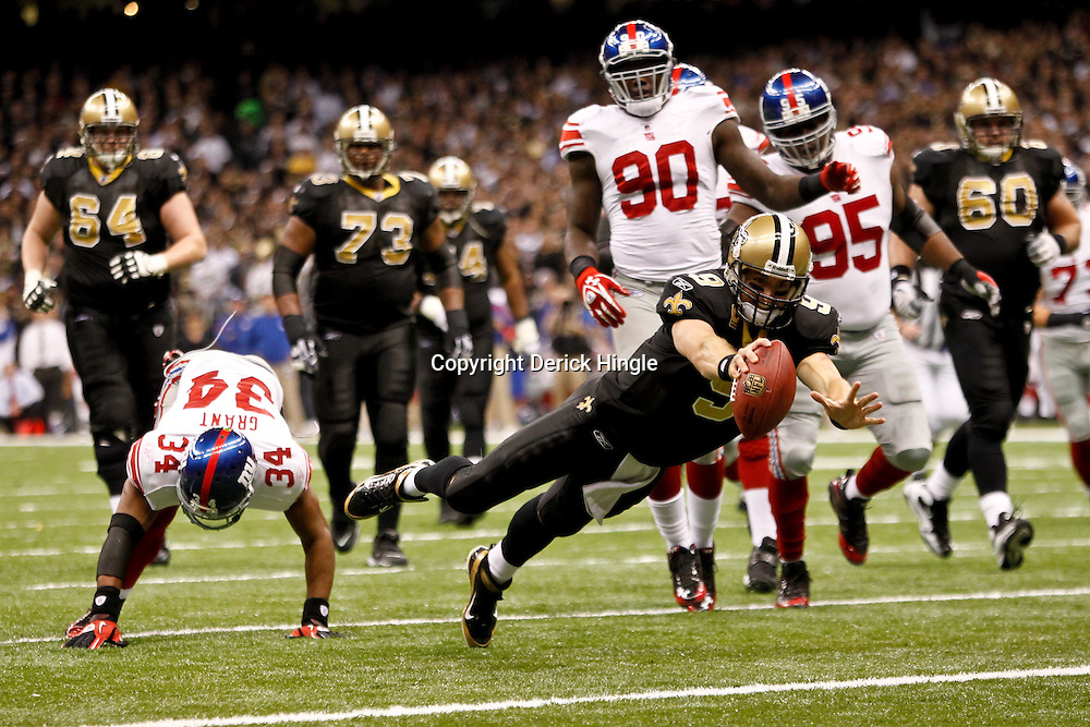 November 28, 2011; New Orleans, LA, USA; New Orleans Saints quarterback Drew Brees (9) dives into the endzone for a touchdown against the New York Giants during the third quarter of a game at the Mercedes-Benz Superdome. Mandatory Credit: Derick E. Hingle-US PRESSWIRE
