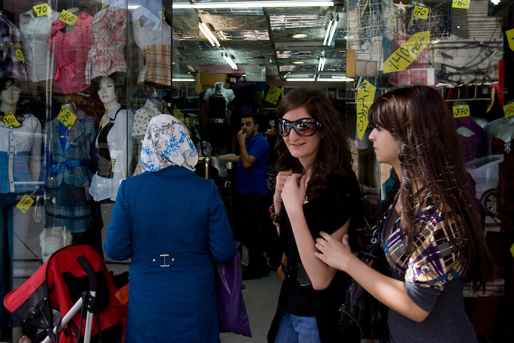 Secular and religious women do shopping on a street close to the Al Manara square...Photo by Olivier Fitoussi