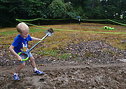 The official groundbreaking ceremony for the new Chrysalis at Merriweather Park Saturday was moved to under a tent roof.  But Johnny Boyle, 5, of Hickory Ridge was shovel-ready afterwards and started his own groundbreaking in the real dirt.  Behind him is the partial green outline of what will be the Chrysalis performance space.