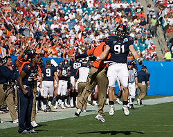 Virginia defensive end Chris Long (91) celebrates with Virginia defensive coordinator Mike London after holding Texas Tech to three plays and out on the opening drive of the Gator Bowl.  The Virginia Cavaliers faced the Texas Tech Red Raiders in the 2008 Konica Menolta Gator Bowl held at the Jacksonville Municipal Stadium in Jacksonville, FL on January 1, 2008.