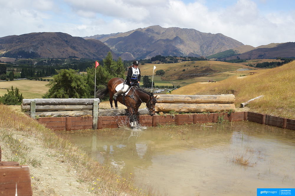Tania Saxton riding Gotta Have Faith in action at the water jump during the Cross Country event at the Wakatipu One Day Horse Trials at the Pony Club grounds,  Queenstown, Otago, New Zealand. 15th January 2012. Photo Tim Clayton