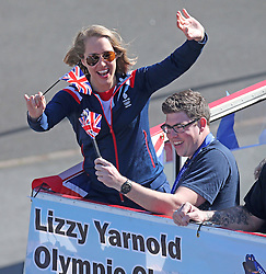 Winter Olympic Gold medalist Lizzy Yarnold (left) sets off on an open top bus parade with her supporters, from Sevenoaks in Kent to her home town of West Kingsdown in Kent, United Kingdom,  Friday, 21st March 2014. Picture by i-Images