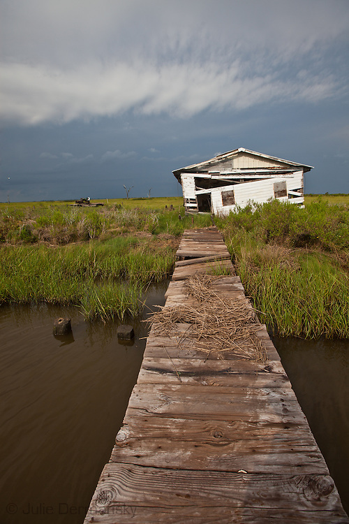 Fishing camp destroyed by a hurricane in the marsh in Pointe-au-Chien Bayou in Pointe-aux-Chien, Louisiana.