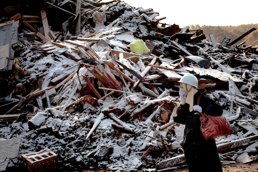 A resident of the town of Taro searches for remains after the earthquake and tsunami hit the town on 11 March 2011.