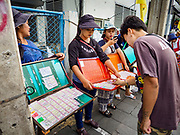 16 JULY 2018 - BANGKOK, THAILAND: Lottery ticket sellers in front of Siriraj Hospital in the Thonburi section of Bangkok.      PHOTO BY JACK KURTZ