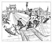 (Soldiers crossing a railway line on rope bridge by a sign that reads 'Passengers must cross the line by the bridge')