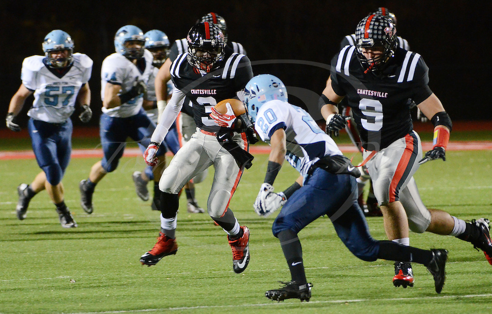 Staff photos by Tom Kelly IV<br /> Coatesville QB Jordan Young (3) runs the ball, as North Penn's Marquise Watson (20) goes in for the tackle during the North Penn at Coatesville District One AAAA high school football game, Friday night November 8, 2013.