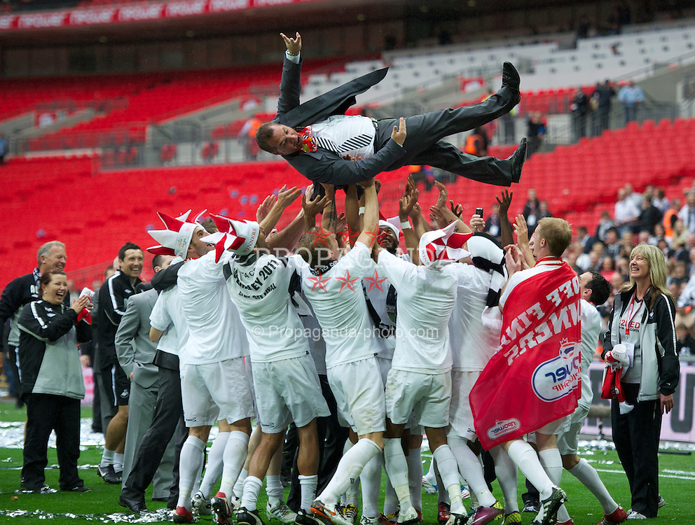LONDON, ENGLAND - Saturday, May 30, 2011: Swansea City's manager Brendan Rodgers is thrown in the air as his players celebrate beating Reading 4-2 during the Football League Championship Play-Off Final match at Wembley Stadium. (Photo by David Rawcliffe/Propaganda)