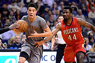 Feb 13, 2017; Phoenix, AZ, USA; Phoenix Suns guard Devin Booker (1) handles the ball in front of New Orleans Pelicans forward Solomon Hill (44) in the first half of the NBA game at Talking Stick Resort Arena. Mandatory Credit: Jennifer Stewart-USA TODAY Sports