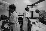 Ruth Nakitende supports her daughter, Patricia Kirabo, 10, as they weight for a nurse to make his rounds at Cure Hospital on February 4, 2017 in Mbale, Uganda. Kirabo is suffering from hydrocephalus, can no longer walk and her neck can not support the weight of her head.