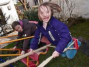 Children enjoying swings.