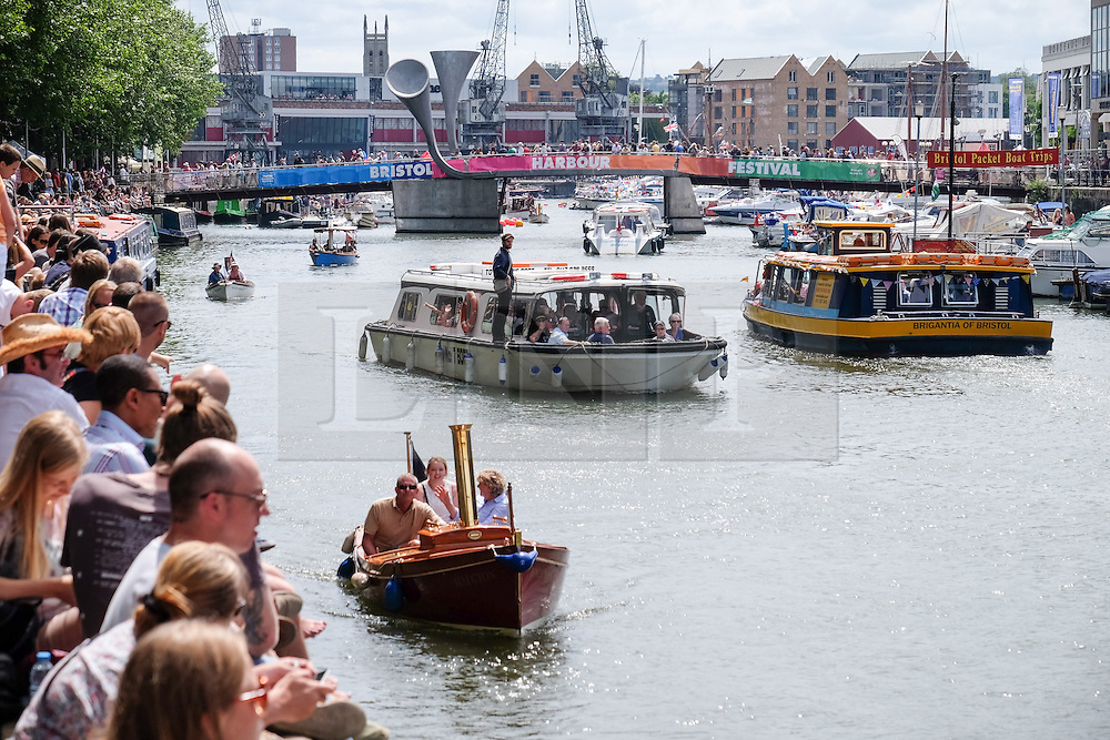 © Licensed to London News Pictures. 18/07/2015. Bristol, UK. People enjoying the warm and sunny weather at Bristol Harbour Festival today, 18th July 2015. The festival expects to draw around 250,000 people over the weekend. Photo credit : Rob Arnold/LNP